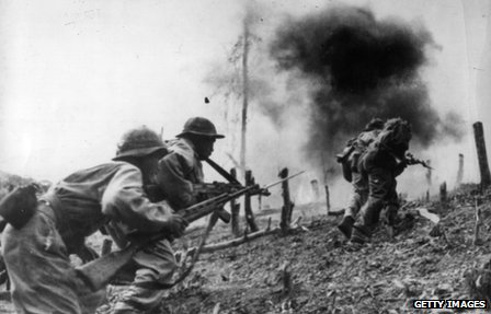 Pathet Lao and North Vietnamese troops fighting imperialist invasion on Laotian territory during Vietnam War.