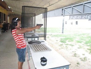 Lao citizen training at shooting range in Vientiane.